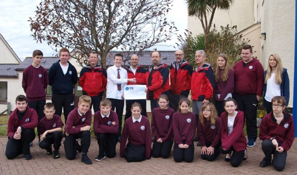 Laxford House Present Cheque to Members of Assynt Mountain Rescue